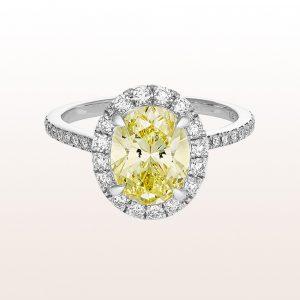 Ring mit ovalem Diamant fancy intense yellow 1,84ct und Brillanten 0,50ct in 18kt Weißgold